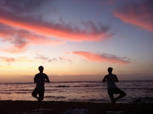 Sunrise yoga on the beach in Kauai, HI
